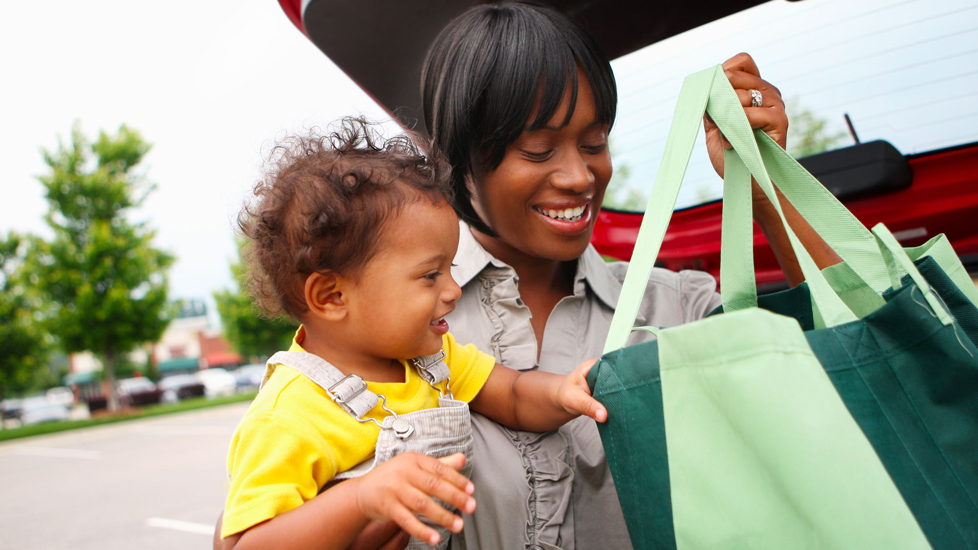 Woman-And-Baby-Loading-Grocery-Tote-Bags