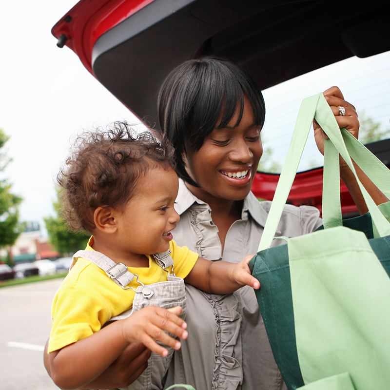Woman With Baby and Shopping totes