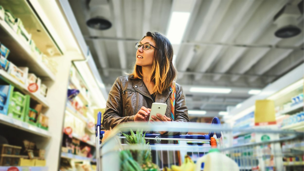 A banner image depicting a person with a shopping cart at the grocery store
